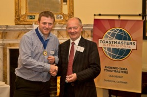 President Brian Price presenting Tony McIntrye with an award 2013