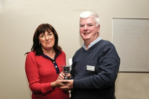 Club Vice President PR Jennifer Ree presents an award to Eamonn McPartland for Best Contribution as Poet Master